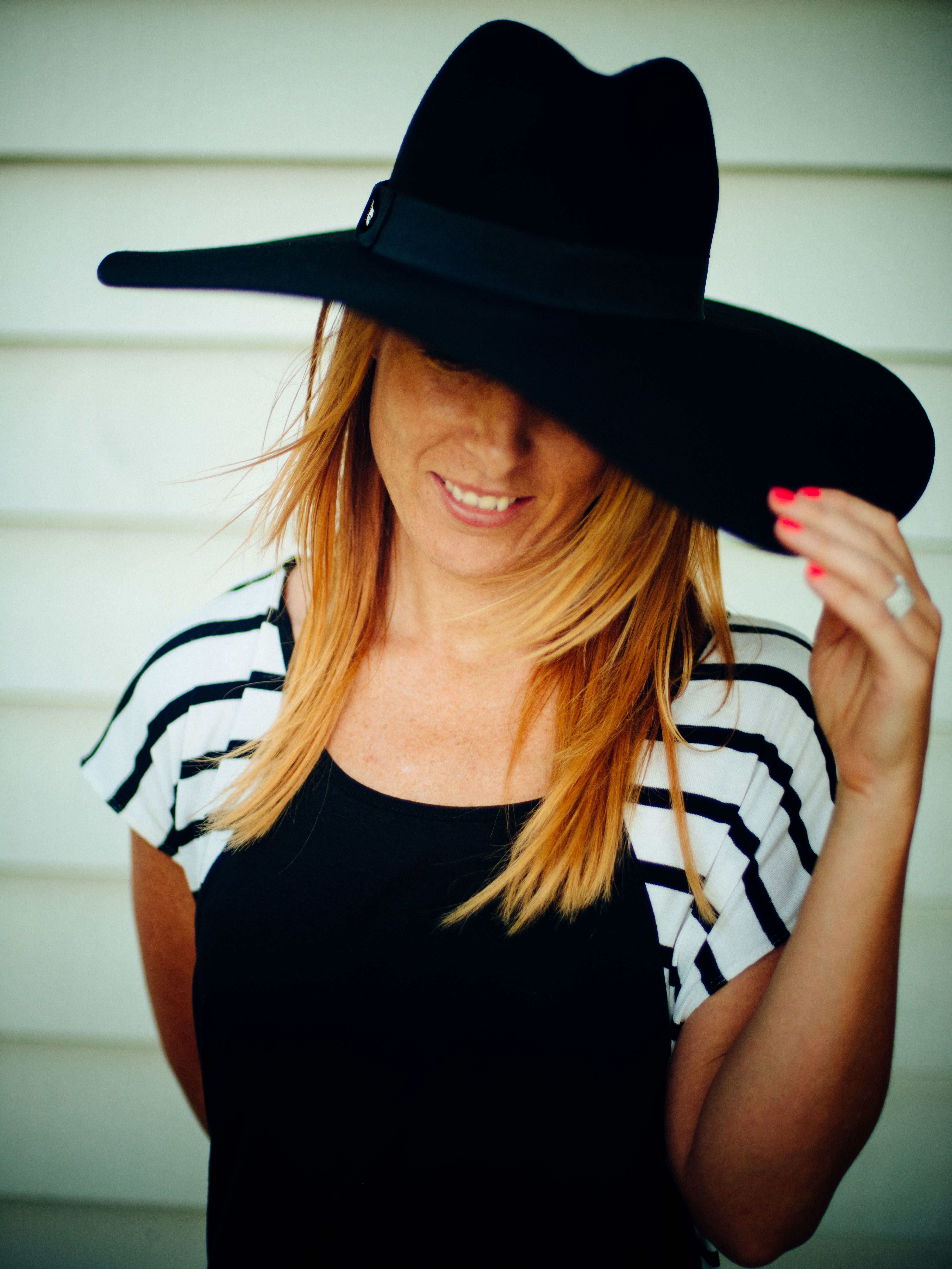 woman looking down with hat