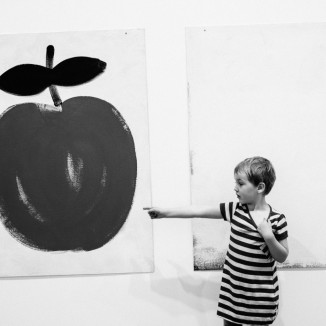 Girl pointing to Apple art