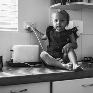 toddler with toaster