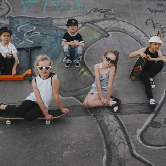 Group of kids sitting on skate park